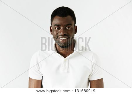 Close Up Of Successful Young Black Entrepreneur Wearing White Polo Shirt Looking And Smiling At The