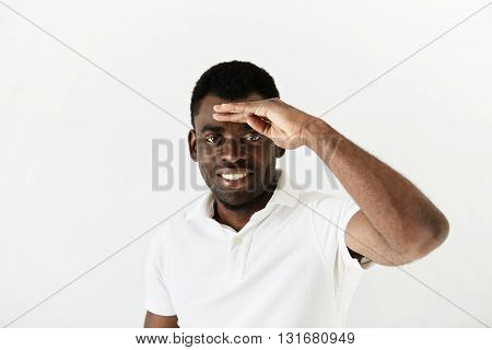 Close Up Portrait Of Young Curious African American Man Peering Ahead Into The Distance, With Hand O