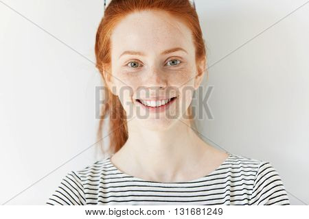 Close Up Shot Of Beautiful Caucasian Student Girl With Ginger Hair And Freckles Wearing Sailor Shirt