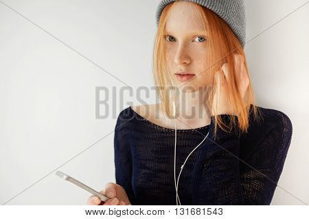 Beautiful Redhead Teenage Girl In Casual Black Top With No Makeup Standing Isolated Against White Co