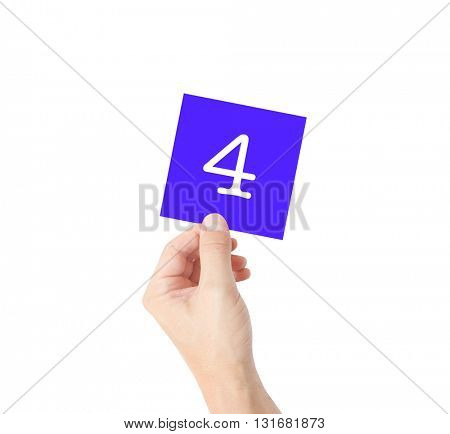 4 written on a card held by a hand