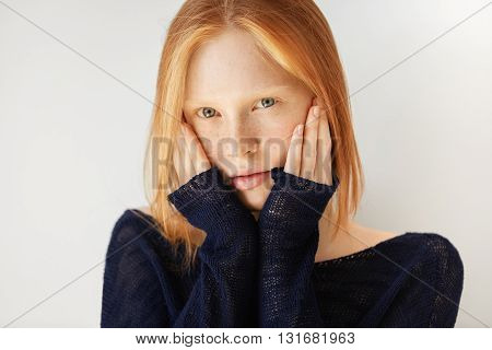 Human Face Expressions And Emotions. Portrait Of Female Teenager With Ginger Hair And Blue Eyes, Wea