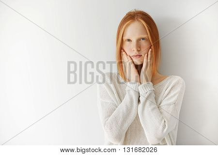 Portrait Of Beautiful Caucasian Female Student Looking At The Camera With Thoughtful Expression, Hol
