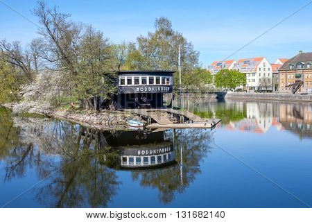 NORRKOPING, SWEDEN - MAY 6, 2016: Motala river and Stromsholmen island during spring in Norrkoping. Norrkoping is a historic industrial town in Sweden.