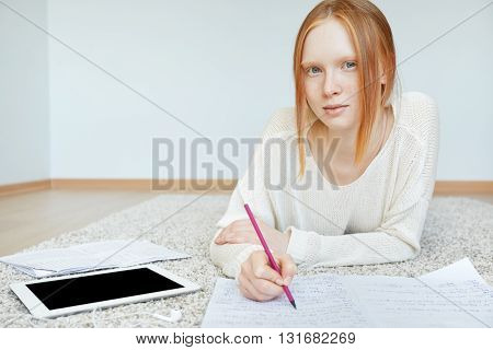 Attractive Teenager With Red Hair And Healthy Freckled Skin Looking And Smiling At The Camera, While