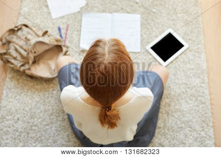 Overhead Shot Of Female Freelancer Working On Her Project While Sitting On The Floor Using Digital T