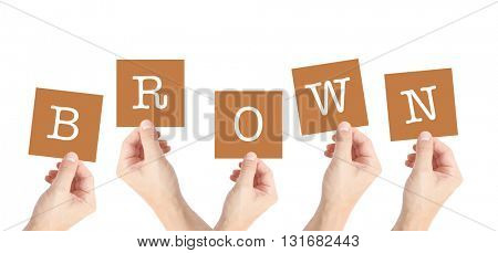 Brown written on cards held by hands