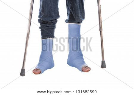 Two Blue Leg Casts And Crutches