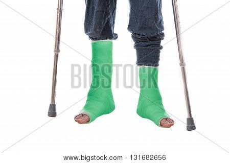 Two Green Leg Casts And Crutches