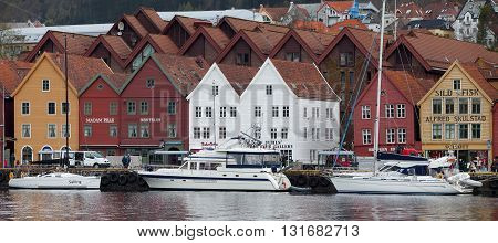 NORWAY, BERGEN - MAY 15, 2012: View of  houses on Bruggen promenade in Vagen bay in the centre of the city of Bergen in Hordaland county, Norway