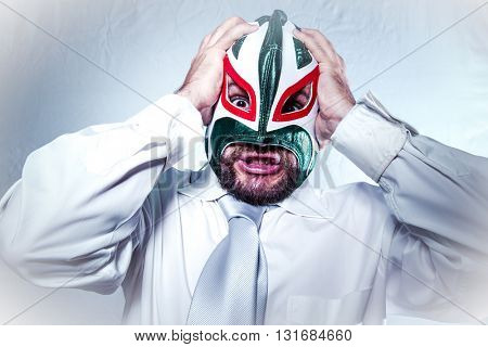 Manager, angry businessman with Mexican wrestler mask, expressions of anger and rage