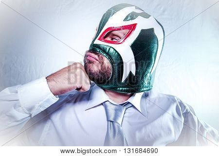Office, angry businessman with Mexican wrestler mask, expressions of anger and rage