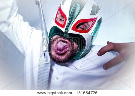 annoyed, angry businessman with Mexican wrestler mask, expressions of anger and rage