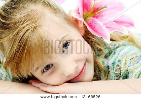 Portrait of a cute 6 years old girl. Isolated over white background.