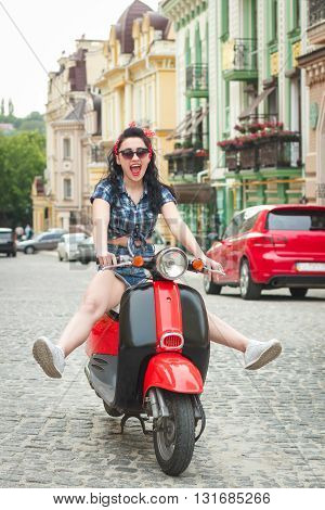 bright young woman on a retro scooter