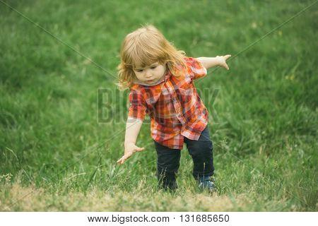 Little Baby Boy On Green Grass