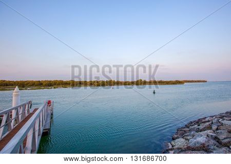 Wooden pier and view of beautiful lake in summer landscape