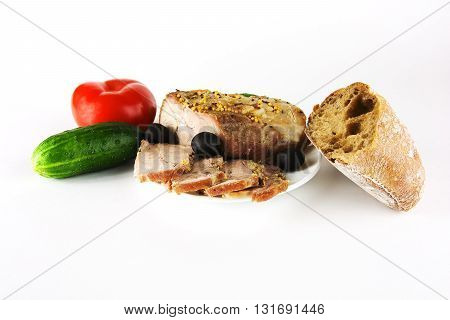 Meat dish with bread and vegetables on a white background