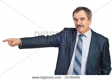 Smiling Mature Business Man Pointing