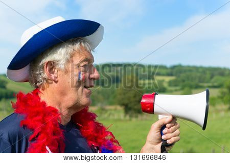 French soccer fan from les bleus in France with megaphone