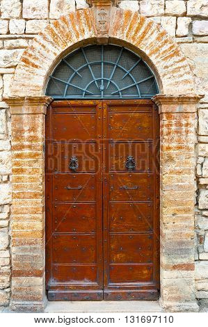Wooden Ancient Italian Door in Historic Center