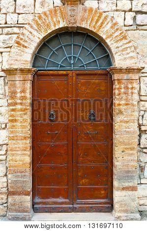 Wooden Ancient Italian Door in Historic Center
