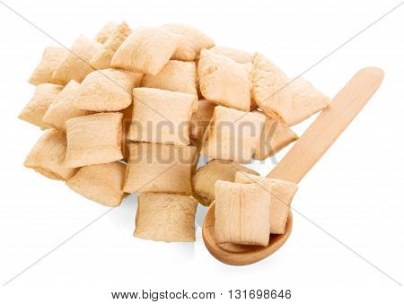 Dry breakfast and a wooden spoon isolated on white background.