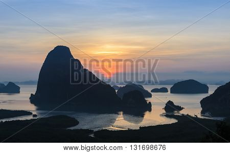 Landscape of limestone karsts in Phang nga bay at sunrise. Unseen place of