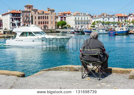 Fisherman Fishing In Saint-jean De Luz - Ciboure Harbour. Aquitaine, France.