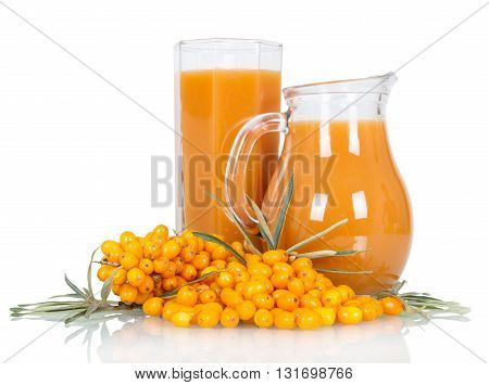 Pitcher and a glass of juice from the berries of sea buckthorn isolated on white background