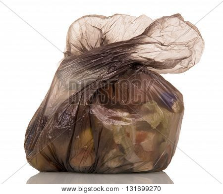 Black plastic garbage bag with isolated on a white background.