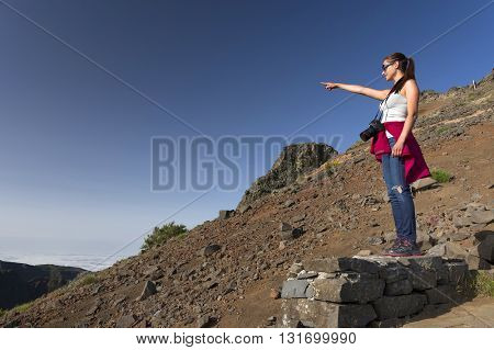 Young woman on Pico do Arieiro, at 1818 meters high - Madeira island's third highest peak, Portugal