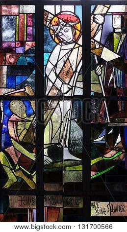 KLEINOSTHEIM, GERMANY - JUNE 08: 2nd Stations of the Cross, Jesus is given his cross, stained glass window in Saint Lawrence church in Kleinostheim, Germany on June 08, 2015.