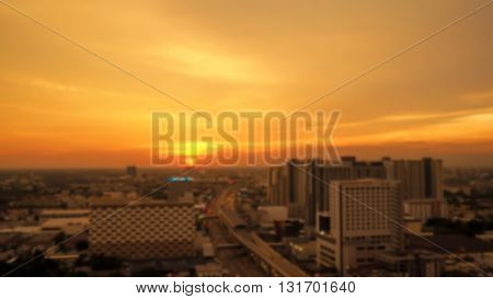 Beautiful view of blur Bangkok city at dusk. Orange skyline in the city at sunset.