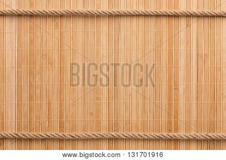 Two straight rope on a bamboo mat with a place for your text
