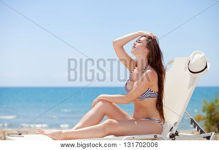 Woman Sunbathing On Hot Summer Day In The Tropics