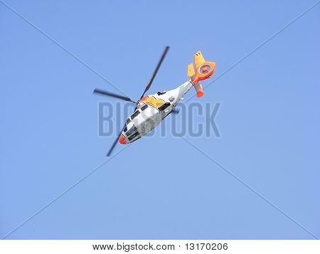 Aerobatic helicopter making loopings in the air