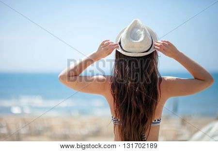 Woman On Beach Looking At The Sea During Summer Vacation