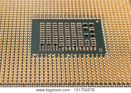 Geometry electronics closeup of CPU Processor Chip view from the bottom side pin connectors as a background texture