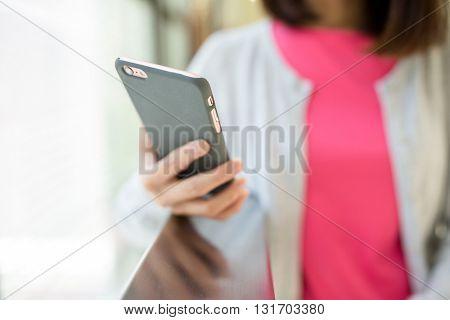 Woman watching on smart phone