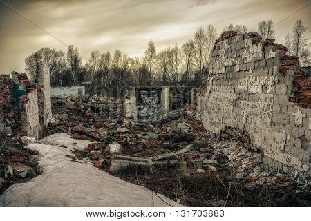Apocalyptic landscape.The remains of destroyed houses covered with snow