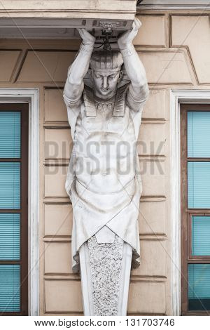 Atlas Statue As Decorative Column Of The Facade