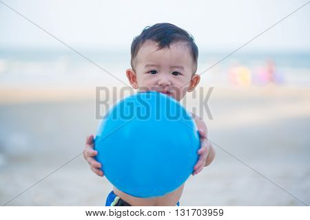 Little Asian Boy 1 Year Old Playing Ball On The Beach