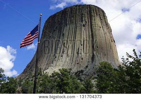 Devil's Tower in Wyoming, the first United States National Monument, is pictured here with the American Flag.