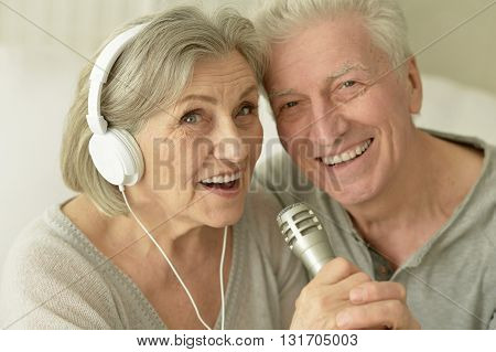 Portrait of a senior couple with headphones and microphone