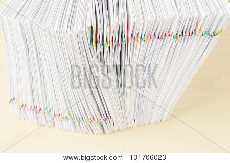 Pile Of Overload Document Place In Vertical On Wooden Table