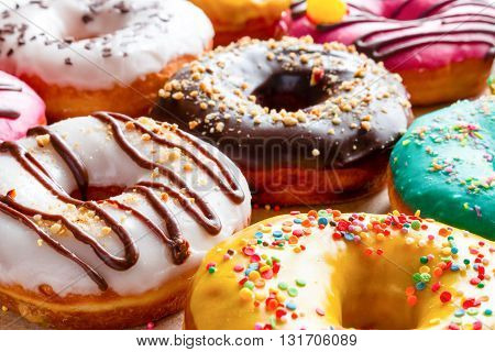 different donuts in multicolored glaze close up