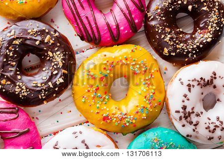 Different Tasty Donuts On A White Background Top View