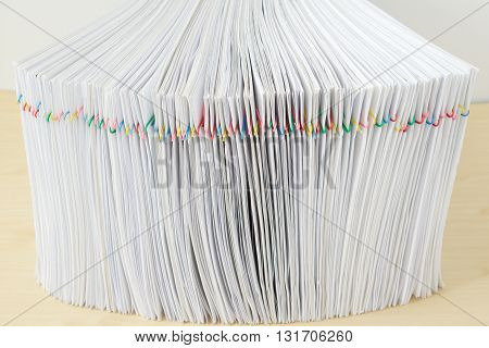Pile Of Overload Sheet Place In Vertical On Wooden Table