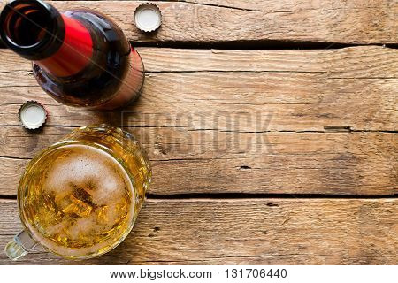Glass Bottle And A Mug Of Light Beer On A Wooden Background Space For Text